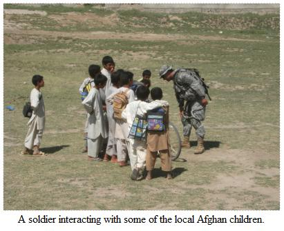 A soldier with local children
